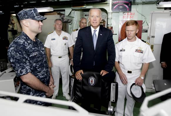 US Vice President Joe Biden, is shown the bridge by Cmdr. Tim Wilke commanding officer of the USS Freedom, the US Navy`s first littoral combat ship on rotational deployment at Changi Naval Base, during his tour to the vessel at the base in Singapore.