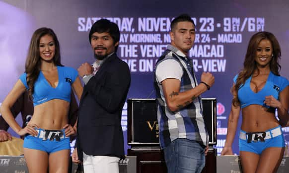 Filipino boxer Manny Pacquiao, center left, poses with Brandon Rios of the United States during a news conference at the Venetian Macao in Macau.