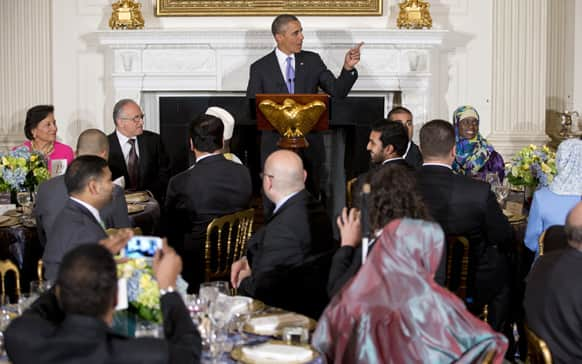 President Barack Obama speaks as he hosts an Iftar dinner celebrating Ramadan in the State Dining Room of the White House in Washington.