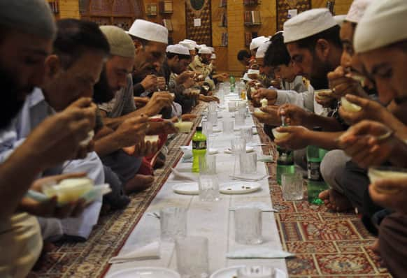 Kashmiri Muslims break their fast inside a mosque during Ramadan in Srinagar.