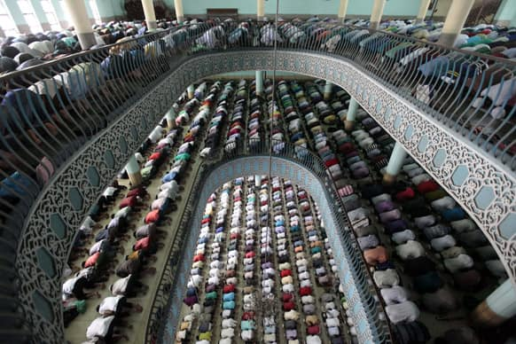Bangladeshi Muslims offer Friday prayers of Ramadan at Baitul Mukaram national mosque in Dhaka.