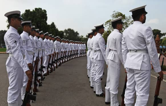 Saliors from navy pay tribute at India Gate war memorial on the 14th anniversary of India`s victory in the Kargil War in New Delhi.