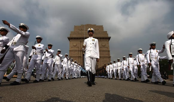 Indian navy personnel pay tribute at India Gate war memorial on the 14th anniversary of India`s victory in the Kargil War in New Delhi.