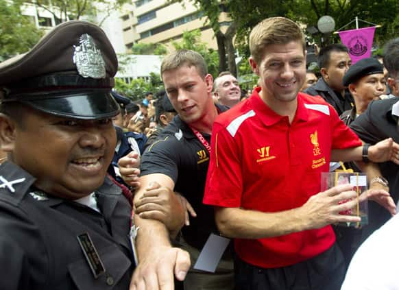 Liverpool`s Steven Gerrard leaves after a visit to pay respects to monarch at Siriraj Hospital in Bangkok, Thailand. The English Premier League team is in Bangkok to play against the Thai national team on July 28.