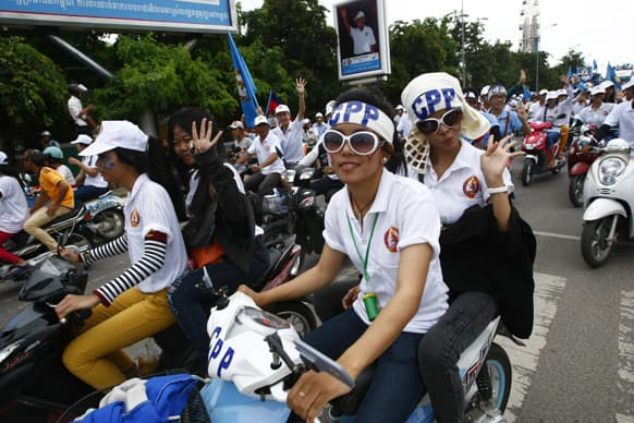Supporters of Prime Minister Hun Sen`s Cambodian People`s Party hold a rally during the final campaign for the July 28 general election in Phnom Penh, Cambodia.