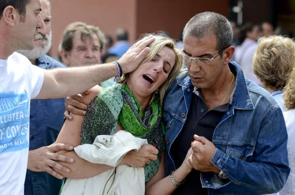 Relatives of victims involved in a train accident react at a victims information point in Santiago de Compostela, Spain.