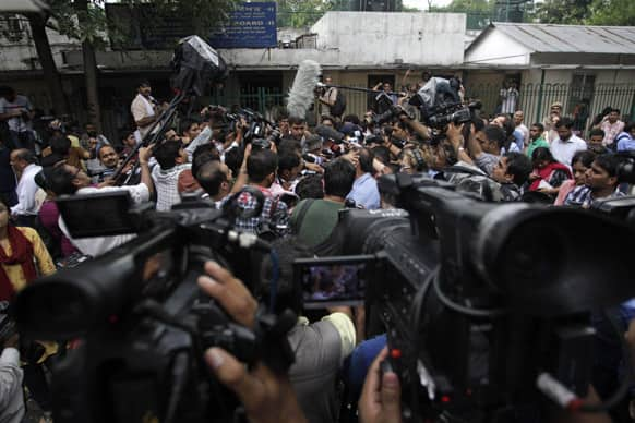 Media personnel gather around defense lawyer Rajesh Tiwari, unseen, outside a juvenile court in New Delhi.