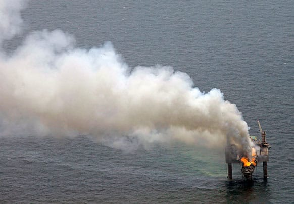 A fire is seen on the Hercules 265 drilling rig in the Gulf of Mexico off the coast of Louisiana. Natural gas spewed uncontrolled from the well on Tuesday after a blowout that forced the evacuation of 44 workers aboard the drilling rig, authorities said.