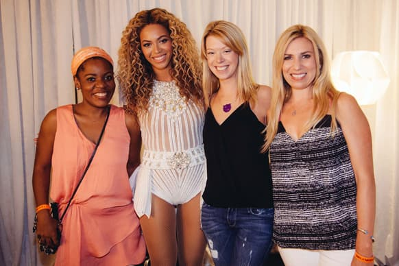 Singer Beyonce poses for a photo backstage with survivors of the Boston bombing before her Mrs. Carter Show World Tour 2013 at the TD Garden in Boston.