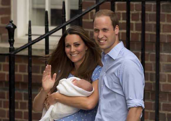 Britain`s Prince William and Kate, Duchess of Cambridge hold the Prince of Cambridge, as they pose for photographers outside St. Mary`s Hospital exclusive Lindo Wing in London where the Duchess gave birth on Monday July 22.