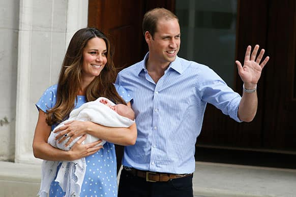 Britain`s Prince William, right, and Kate, Duchess of Cambridge, hold the Prince of Cambridge, as they pose for photographers outside St. Mary`s Hospital exclusive Lindo Wing in London where the Duchess gave birth on Monday July 22.