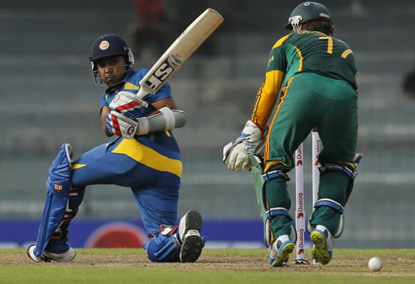 Sri Lankan cricketer Mahela Jayawardene bats as South African wicketkeeper AB de Villiers watches during their second one-day international cricket match in Colombo, Sri Lanka.