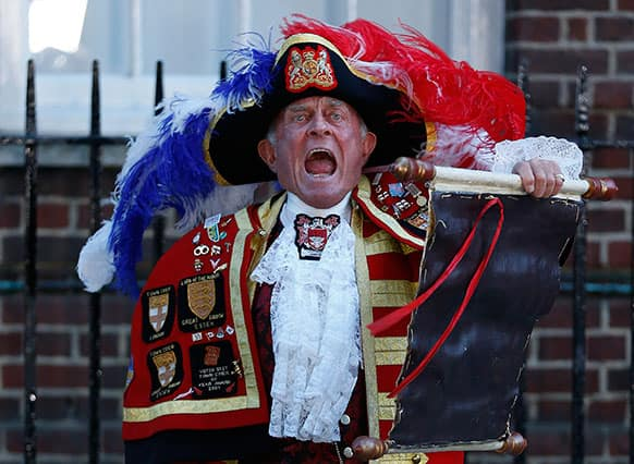 Tony Appleton, a town crier, announces the birth of the royal baby, outside St. Mary`s Hospital exclusive Lindo Wing in London. Palace officials say Prince William`s wife Kate has given birth to a baby boy.