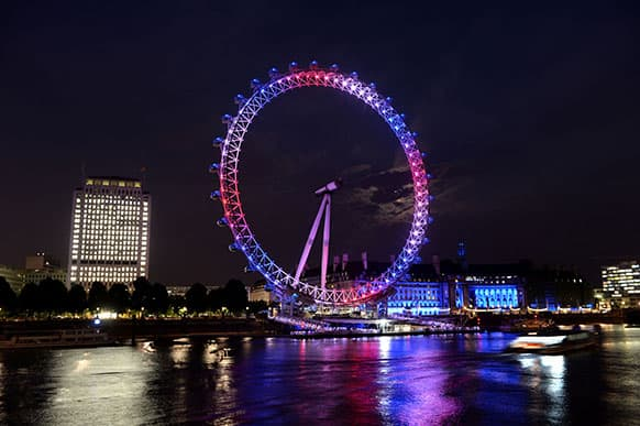 The London Eye observation wheel on the banks of the river Thames celebrates the birth of the Duke and Duchess of Cambridge`s son by lighting up in the national colors of red, white and blue.