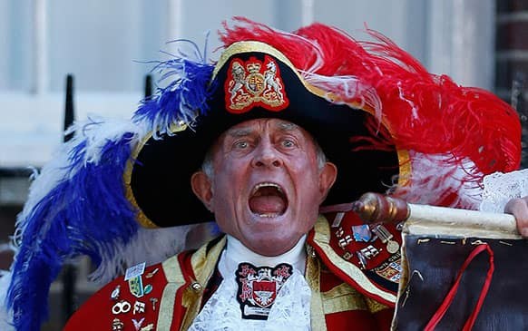 Tony Appleton, a town crier, announces the birth of the royal baby, outside St. Mary`s Hospital exclusive Lindo Wing in London. Palace officials say Prince William`s wife Kate has given birth to a baby boy. The baby was born at 4:24 p.m. and weighs 8 pounds 6 ounces.