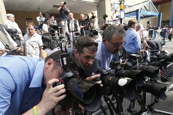 Photographers adjust their camera`s outside St. Mary`s Hospital exclusive Lindo Wing in London.