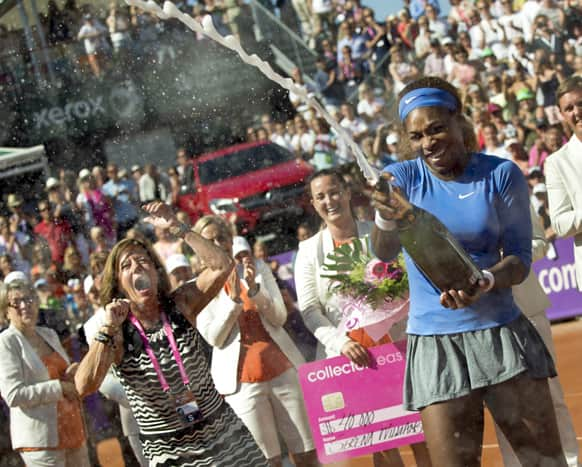 Serena Williams celebrates after winning her 53rd WTA title by beating Johanna Larsson, not shown, by 6-4, 6-1 in the final of the Swedish Open.