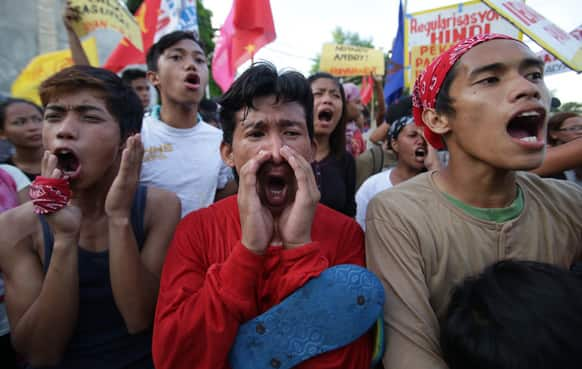 Filipino protesters shout slogans as they tried to get closer to the house of Philippine President Benigno Aquino III in suburban Quezon city, north of Manila.