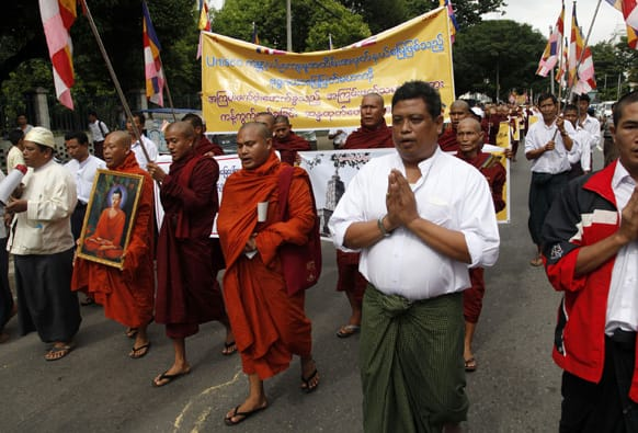 Myanmar Buddhist monks and others march during a protest against recent bombing in Buddha Gaya, in Yangon, Myanmar.