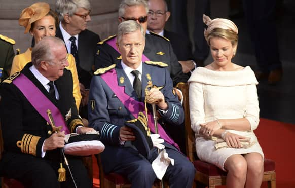 Belgium`s King Albert II, left, Prince Philippe, center, and his wife Princess Mathilde attend a church service at the St. Gudule cathedral in Brussels.