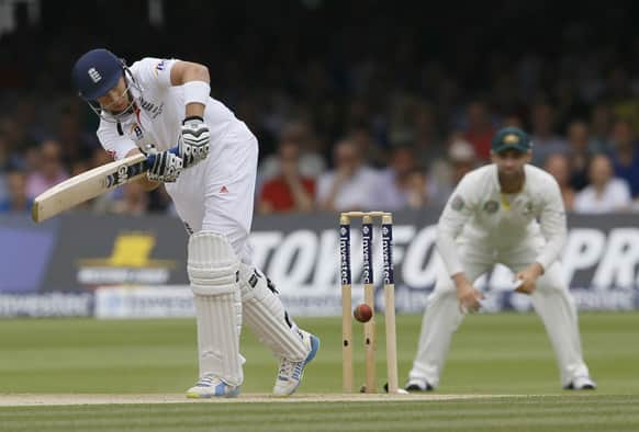 England`s Joe Root plays a shot off the bowling of Australia`s Peter Siddle during day three of the second Ashes Test match held at Lord`s cricket ground in London.