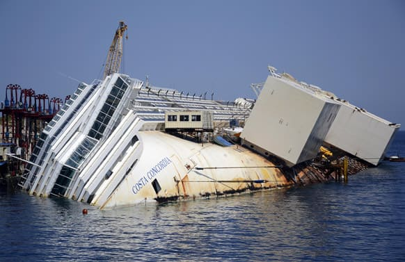 The Costa Concordia cruise ship lies on its side in the Tuscan Island of Isola del Giglio.