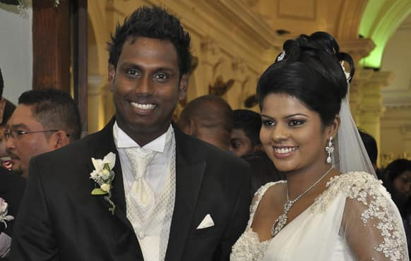 Sri Lankan cricket captain Angelo Mathews, left, and his bride Heshani leave a church after their wedding service in Colombo, Sri Lanka.