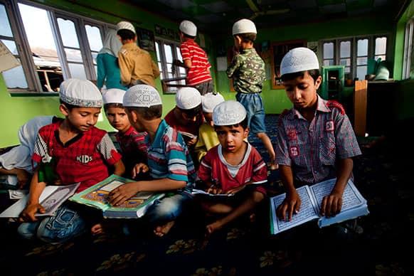 Kashmiri Muslim children attend recitation classes of the Quran at a local Madrasa or Muslim religious school, during Ramadan in Srinagar.