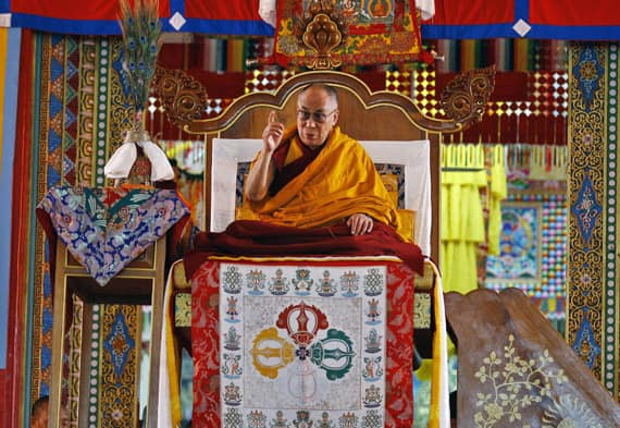 Tibetan spiritual leader the Dalai Lama sits on a throne as he delivers a religious sermon on the last day of five day teachings at the Gyudmed Tantric Monastery in Gurupura 212 kilometers (132 miles) southwest of Bangalore.
