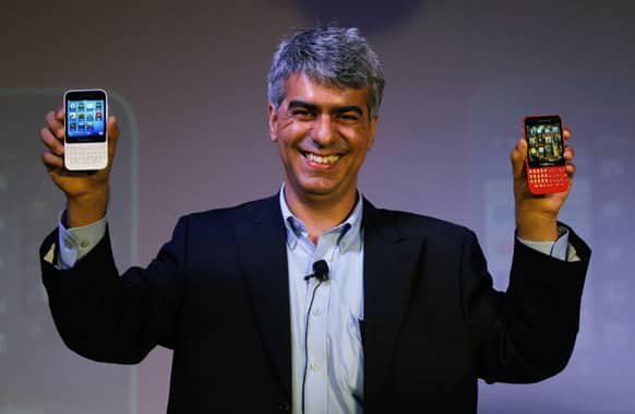 BlackBerry India Managing Director Sunil Lalwani displays BlackBerry Q5 smartphones during its launch in New Delhi. BlackBerry Q5 is priced at Rupees 24,990 ($416).