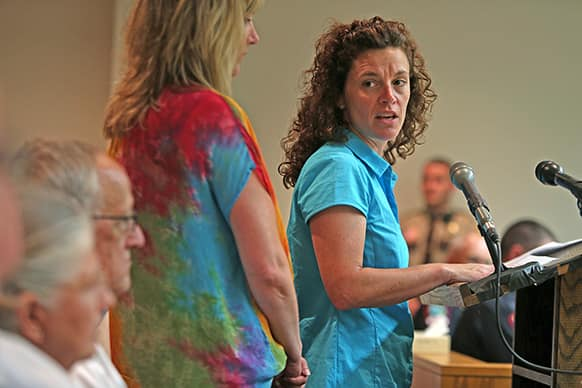 Mary Elizabeth Stotz turns toward Aaron Schaffhausen`s parents during his sentencing hearing in Hudson, Wis. Schaffhausen, who killed his three daughters last year in an act of revenge against his ex-wife, was sentenced to life in prison with no chance of parole.