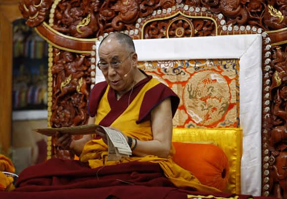 Tibetan spiritual leader the Dalai Lama sits on a throne as he delivers a religious sermon at the Gyudmed Tantric Monastery in Gurupura 212 kilometers (132 miles) southwest of Bangalore.