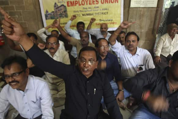 Employees of India`s state-run telecommunications company shout slogans as they protest against the shutting down of the 163-year-old telegram service at the central telegraph office in Mumbai.