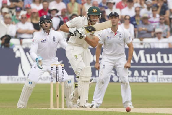 Australia`s Ashton Agar, centre, plays a shot off the bowling of England`s Graeme Swann on the final day of the opening Ashes series cricket match at Trent Bridge cricket ground, Nottingham, England.