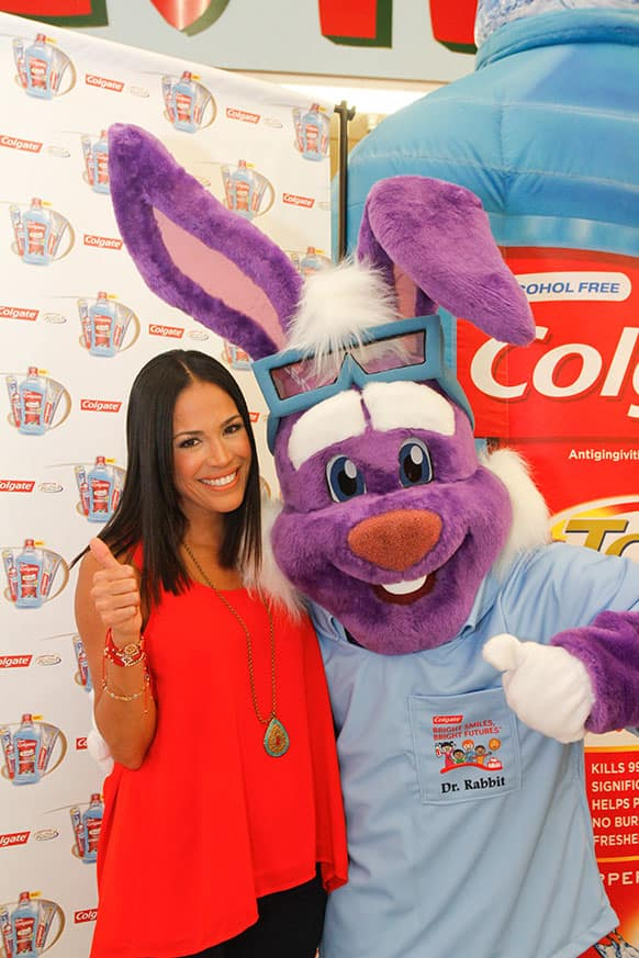Karla Martinez poses with Dr. Rabbit at an event organized by Colgate-Palmolive and the Hispanic Dental Association to encourage Hispanics to take charge of their oral health in Houston.
