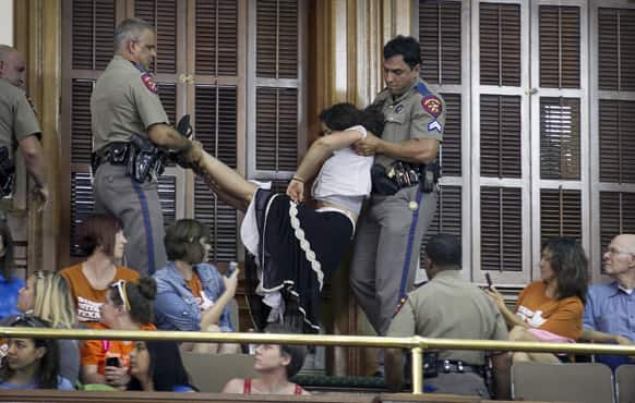 DPS troopers arrest a woman in the Senate Chamber at the Capitol in Austin, Texas, during the abortion debate.