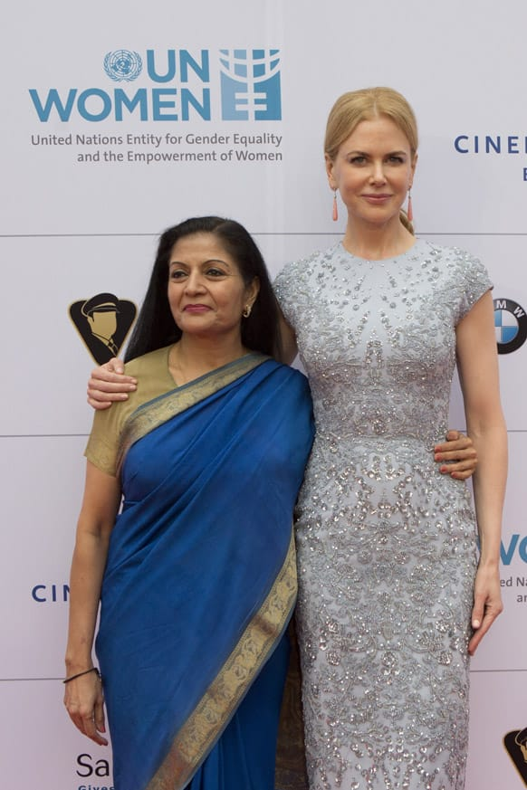 Actress Nicole Kidman, left, and the acting head of UN Women Lakshmi Puri attend the Cinema For Peace fundraising dinner in Berlin.