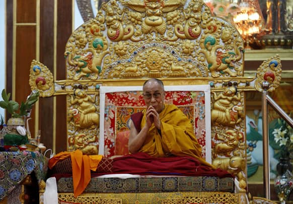 Tibetan spiritual leader the Dalai Lama gestures before delivering a sermon during a religious congregation at the Dzongar Chodhe Monastery in Gurupura, 210 kilometers (131 miles) southwest of Bangalore.