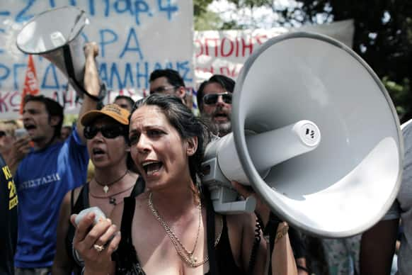 Municipality workers chant slogans during a protest, against new austerity cuts that will affect thousands of public sector workers, in Athens.