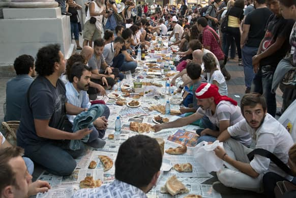People break fast, sharing food on Istiklal avenue, in Istanbul, Turkey.