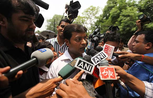 Rajesh Tiwari, defense lawyer for the accused juvenile in the Delhi gang rape case, speaks to media personnel outside the Juvenile Justice Board building in New Delhi.