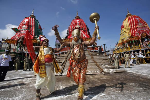 Traditional dancers of the Shree Jagannath temple dance during the annual Rath Yatra or chariot procession of Lord Jagannath in Puri, 60 kilometers (37 miles) from the eastern Indian city of Bhubaneswar.