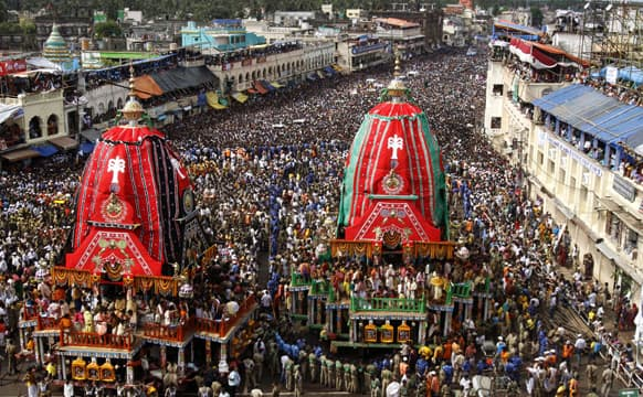 Devotees throng around the chariot of Lord Jagannath and his sister Subhadra during the annual Rath Yatra or chariot procession in Puri, 60 kilometers (37 miles) from the eastern Indian city of Bhubaneswar.