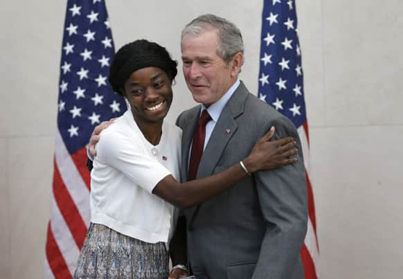 Former President George W. Bush posses for a photo with Mondell Bernadette Avril after she was sworn in as a U.S. citizen during a ceremony at the The George W. Bush Presidential Center in Dallas. Twenty new citizens took the oath of US citizenship at the former president`s library.