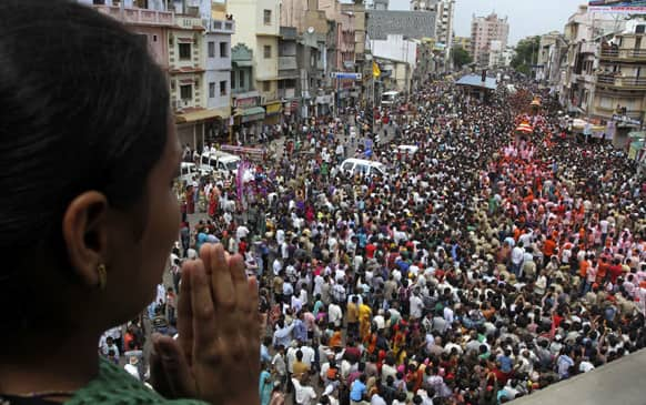 A woman worships as thousands of devotees participate in the annual chariot procession of Hindu god Lord Jagannath in Ahmadabad.
