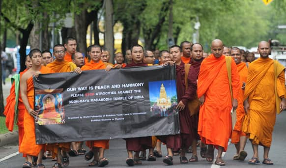 Buddhist monks gather outside the United Nations office in Bangkok, Thailand, to demand peace after a series of blasts at Bodh Gaya in eastern India.