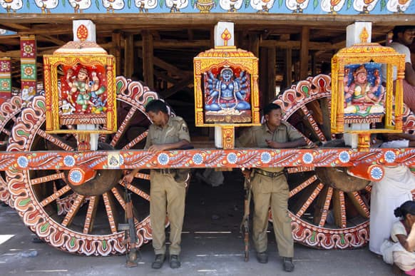 Policemen stand guard near a chariot meant for the annual Rath Yatra or Chariot procession of Lord Jagannath in Puri, 60 kilometers (37 miles) from the eastern Indian city of Bhubaneswar.