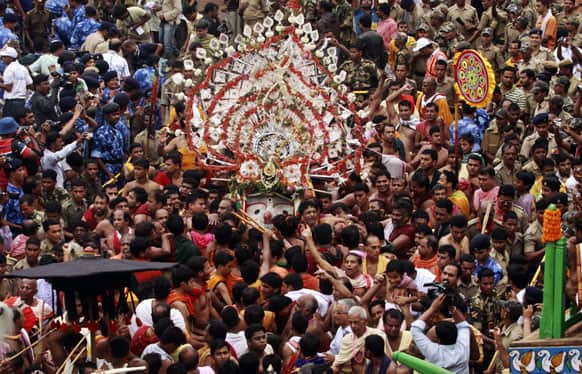 FILE PHOTO: Hindu devotees and temple priests gather around an idol of a Hindu God Balabhadra as they participate in the annual festival of Rath Yatra, or chariot procession, in Puri, Orissa.