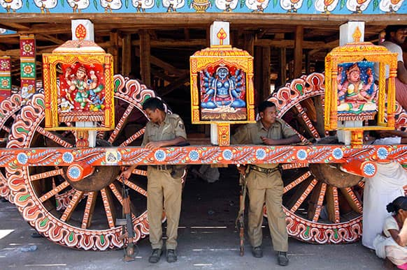 Indian policemen stand guard near a chariot meant for the annual Rath Yatra or Chariot procession of Lord Jagannath in Puri, 60 kilometers (37 miles) from the eastern Indian city of Bhubaneswar.