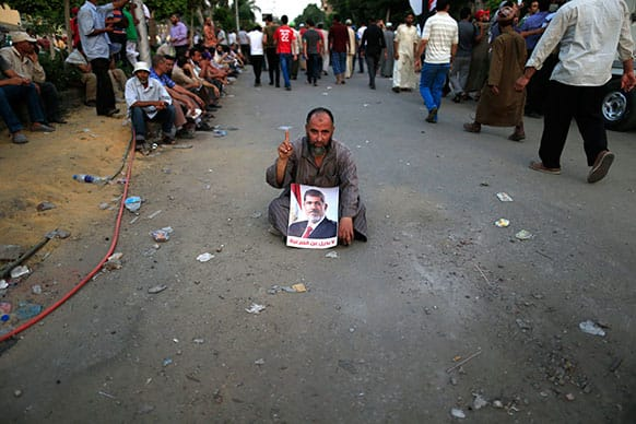 Supporters of ousted President Mohammed Morsi protest at the Republican Guard building in Nasr City, Cairo, Egypt.